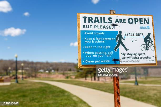 A poster lists the rules to follow on a trail during the coronavirus COVID19 pandemic on April 20 at Falls Park in Sioux Falls South Dakota For...