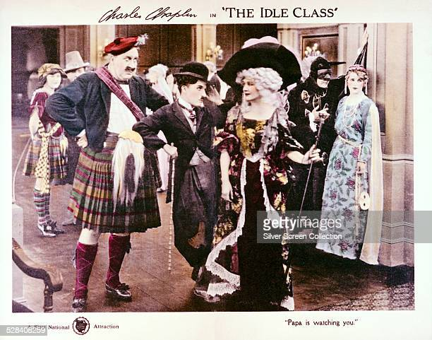 A poster lobby card for Charlie Chaplin's 1921 silent comedy 'The Idle Class' starring Mack Swain Chaplin and Edna Purviance