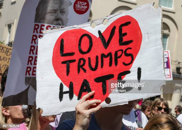 A poster 'love Trumps hate' is seen during a demonstration against the visit to the UK by US President Donald Trump on July 13 2018 in London England