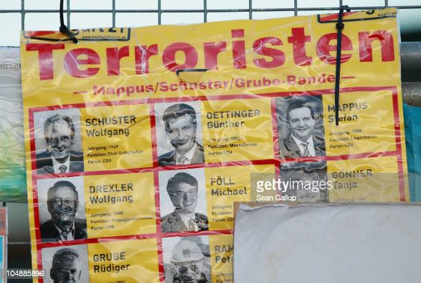A poster naming local government officials as terrorists hangs among messages left by protesters on a fence outside Hauptbahnhof train station on...