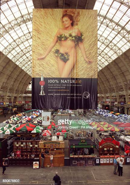 A poster of a scantilyclad woman on a bed of barley adorns the Great British Beer Festival in a bid to attract young and female drinkers to real ale...