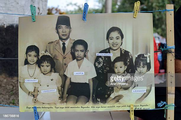 A poster of a Sukarno family portrait sold in a yard outside Gebang Palace the childhood home of the first Indonesian president Sukarno Blitar city...