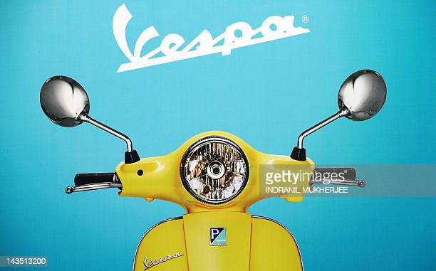 A poster of a Vespa scooter and logo is displayed at the newly inaugurated Vespa plant at Baramati some 150 kms south east of Pune in the western...