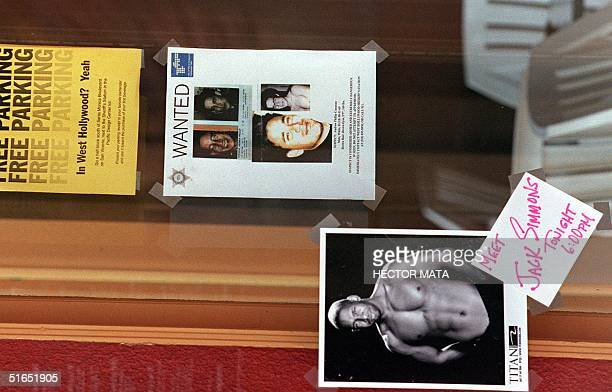 Poster of Andrew Cunanan, the number one suspect in the killing of designer Gianni Versace, is displayed at the entrance of a bar in West Hollywood,...