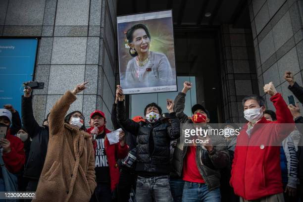 Poster of Aung San Suu Kyi is held aloft as Myanmarese people demonstrate against the military coup that took place in their home country earlier...