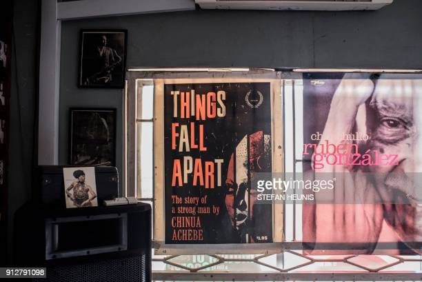 A poster of Chinua Achebes book Things Fall Apart is seen in the window of The Jazz Hole on January 30 2018 The Jazz Hole is an independent record...