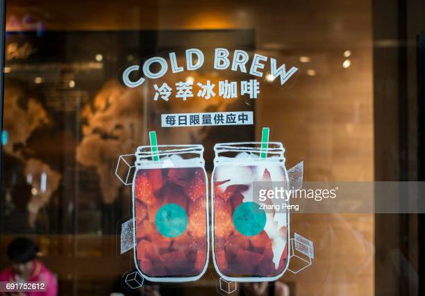 Poster of cold brew products in shop window to attract more young customers in summer In the second quarter of 2017 Starbucks opened its stores to...