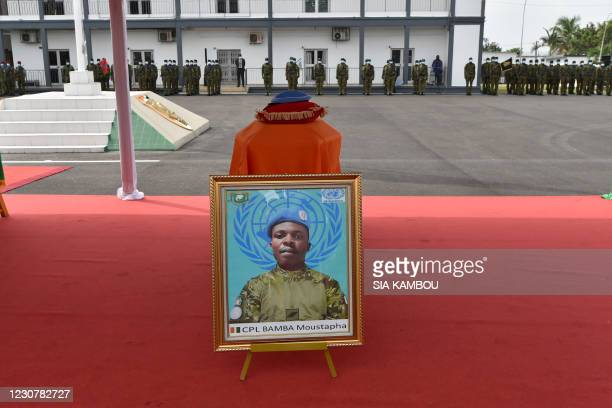 Poster of Corporal Bamba Moustapha, one of the four Ivorian peacekeepers that was killed, is seen during a tribute ceremony, at the army headquarters...