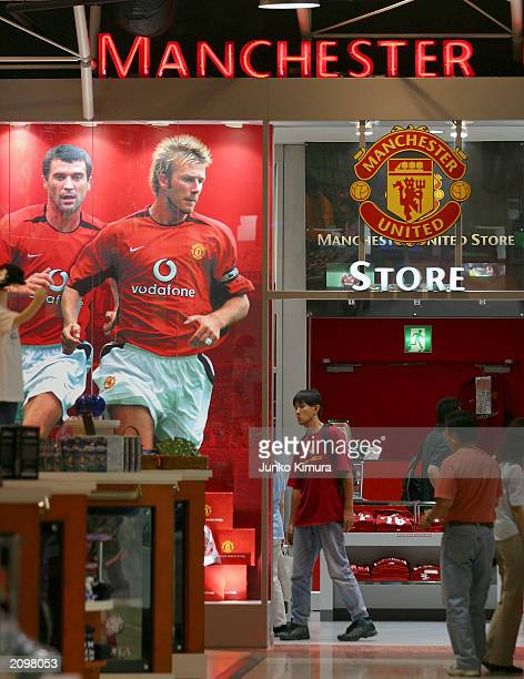 A poster of David Beckham playing for Manchester Utd appears in a shop on June 20 2003 in Tokyo Japan David and Victoria Beckham are in Japan for a...