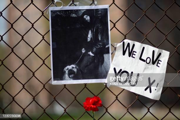 Poster of DMX is left at a makeshift memorial for hip-hop star DMX outside White Plains Hospital in White Plains, New York, on April 10, 2021. - DMX,...