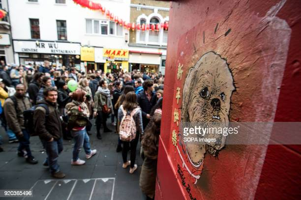 A poster of dog seen seen at Chinatown to celebrate the year of dog in chinese calendar Londoners gather in London's chinatown and trafalgar square...