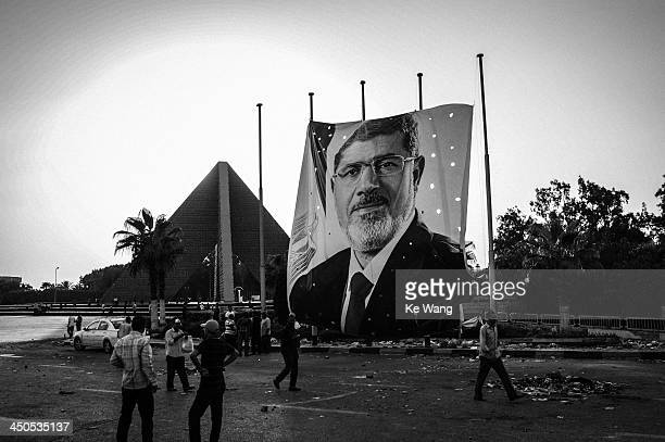CONTENT] A poster of Egypt's ousted president Mohamed Morsi is seen in front of the Unknown Soldier Memorial in Cairo Egypt July 29 2013