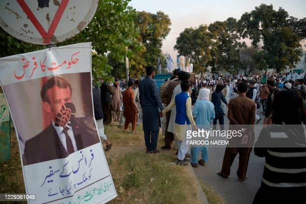Poster of French President Emmanuel Macron's hangs on a pole during a protest in Islamabad on October 30 following the French President Emmanuel...