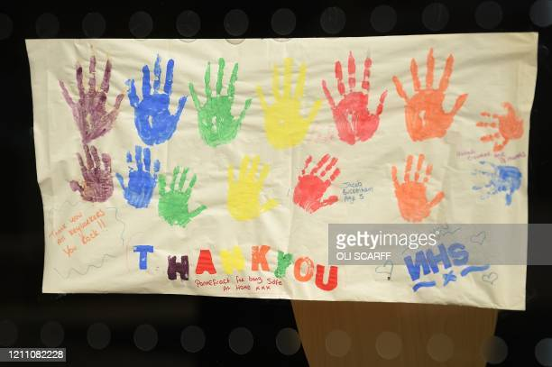 Poster of handprints depicting the colours of a rainbow, being used as symbols of hope during the COVID-19 pandemic are seen in Pontefract, northern...