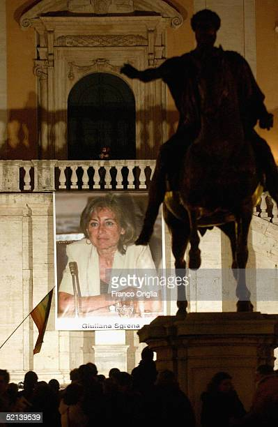 Poster of kidnapped journalist Giuliana Sgrena is seen during a meeting of solidarity in the Capitole Square on February 5 in Rome, Italy. Sgrena was...
