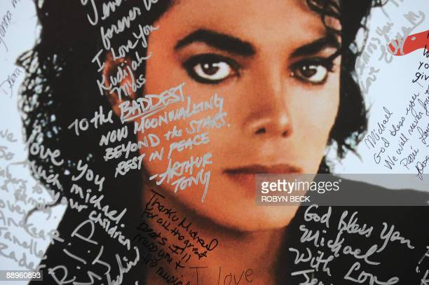A poster of Michael Jackson is covered with messages from fans at a oneday tribute to the 'King of Pop' which included outdoor screenings of 'The...