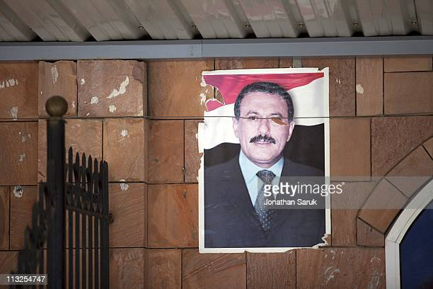 A poster of President Ali Abdullah Saleh pasted on the wall in a stadium after the president gave a speech to thousands of supporters on March 10...