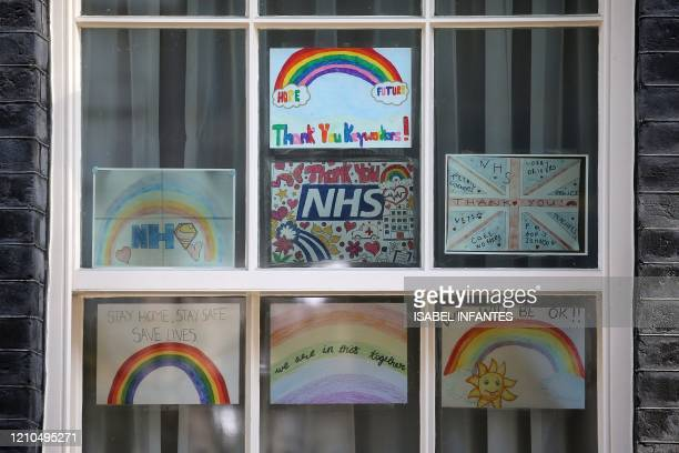 Poster of rainbows, being used as symbols of hope during the COVID-19 pandemic, and messages of thanks for the workers of Britain's NHS are seen in...