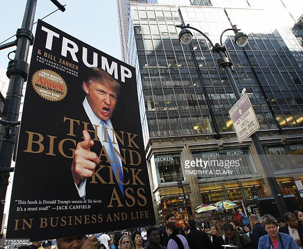 A poster of real estate developer Donald J Trump hangs before he arrived to promote his new book written with Bill Zanker president and founder of...