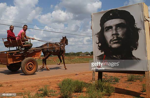 A poster of Revolutionary hero Che Guevara is seen next to the road a day after the second round of diplomatic talks between the United States and...