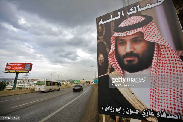 A poster of Saudi Arabia's Crown Prince Mohammed bin Salman with a phrase reading in Arabic ' God protect you' is seen on a highway in the northern...