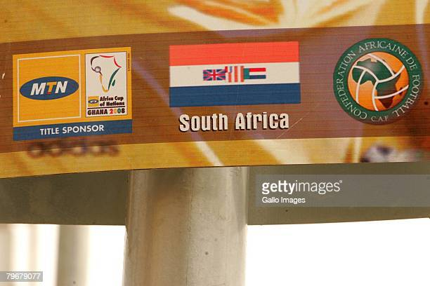 A poster of South African football striker Benni McCarthy with South Africa's old flag remains on the street during the Africa Cup of Nations despite...