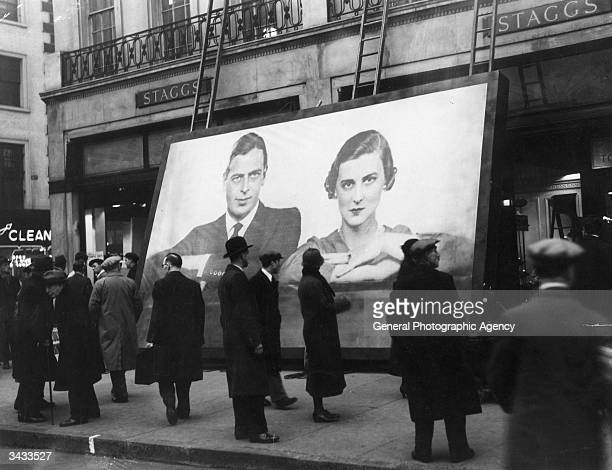 A poster of the Duke of Kent and Princess Marina of Greece about to be put up in preparation for the royal couple's wedding