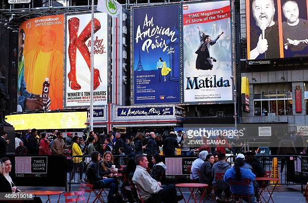 A poster of the musical show 'An American in Paris' is seen among with other shows at the Palace Theater in New York on April 12 2015 during its...