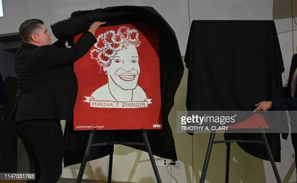 A poster of transgender activist Marsha P Johnson is unveiled during an event at the The Lesbian Gay Bisexual Transgender Community Center in New...
