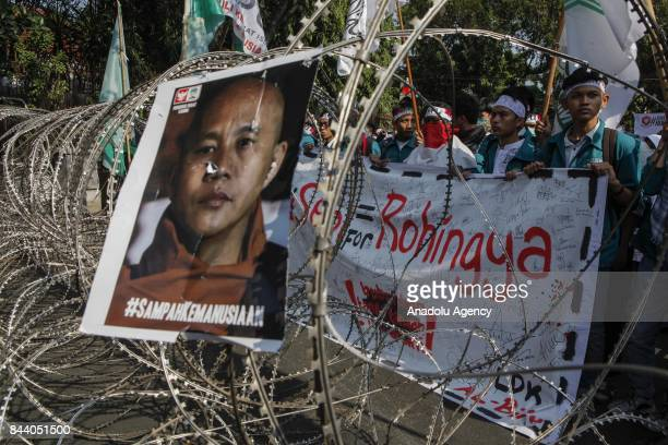 A poster of Wirathu who is the leader of Myanmar's nationalist Buddhist monks hanging on a security barrier during a protest outside of Myanmar...