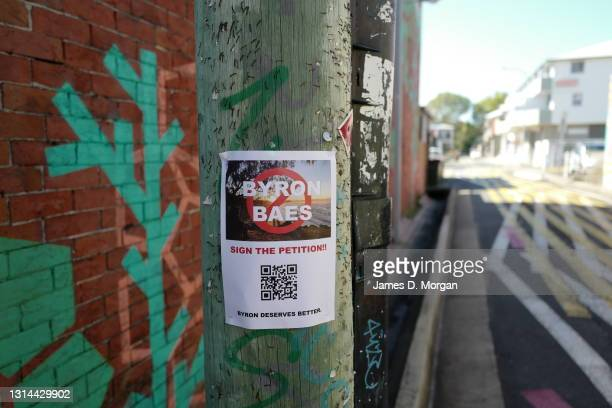 "Poster on a telegraph pole asking for the community to sign an online petition against the Netflix programme ""Byron Baes"" to be filmed in the town..."