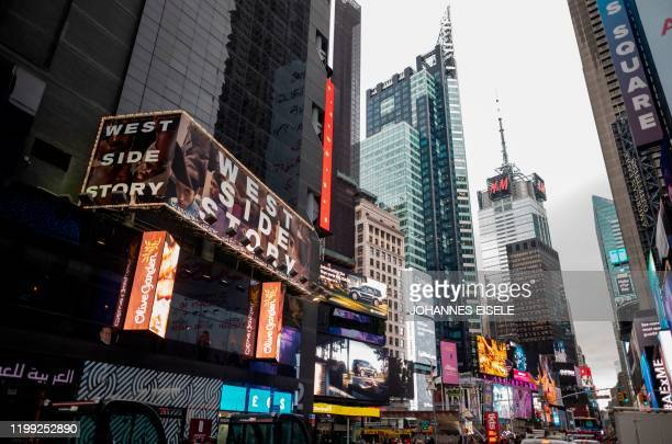 A poster on Times Square advertises West Side Story at the Broadway Theater on February 7 2020 in New York City Westside Story is returning to...