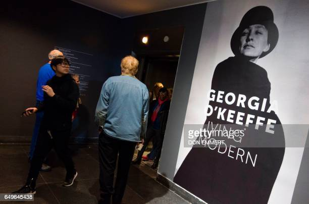 A poster outside the elevator announces the Georgia O'Keeffe exhibit at the Brooklyn Museum March 8 2017 in New York Everyone knows her magnified...