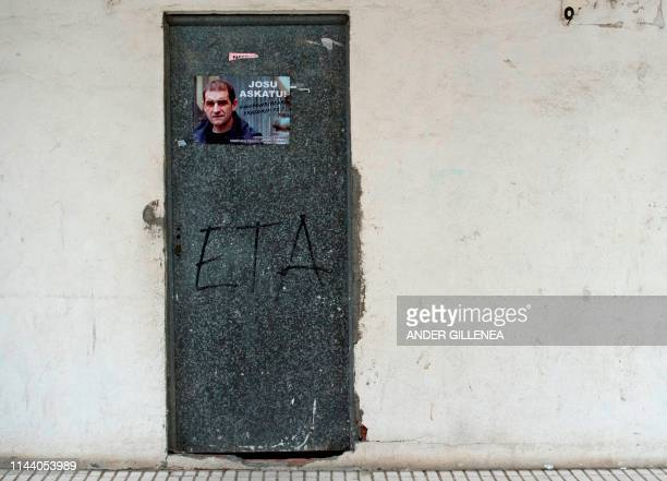 TOPSHOT A poster pasted on a door calls for the release of one of the most influential leaders of former Basque separatist group ETA Jose Antonio...