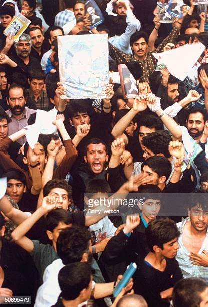 Poster picturing surprise front-runner presidential candidate Mohammed Khatami held high by 1 in crowd of moderate cleric's enthused supporters at...