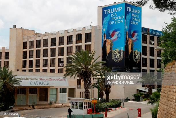 A poster praising US President Donald Trump covers an outside section of the 'Diplomat Hotel' adjacent to the US consulate in Jerusalem which will...