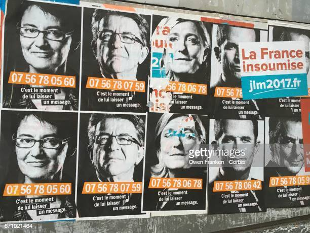 A poster presents portraits of French presidential candidates Nathalie Arthaud of the Lutte Ouvrière JeanLuc Melanchon who is backed by the Communist...