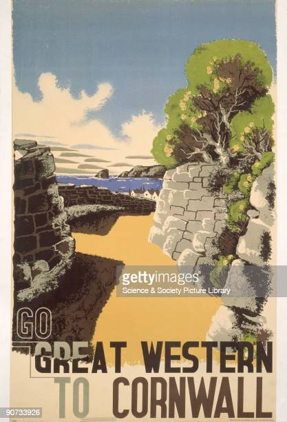 Poster produced for the Great Western Railway to promote rail travel to Cornwall The poster shows a view of a sandy path lined with stone walls...