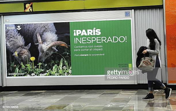 A poster promotes the city of Paris in a subway station in Mexico City on November 24 2016 Mayors from more than 85 megacities from around the globe...