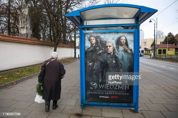 A poster promoting 'The Witcher' Netflix television series is seen at a bus stop in Krakow Poland on 20 December 2019 Netflix 'The Witcher' created...