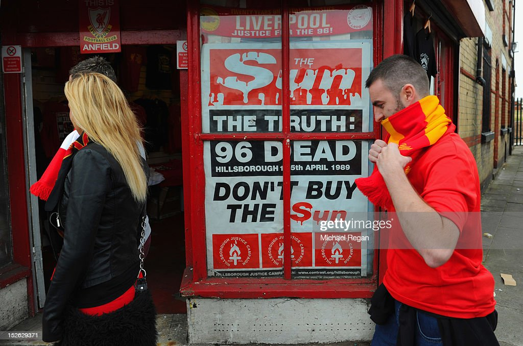 A poster protesting about the way in which Liverpool fans were blamed for the Hillsborough disaster is displayed outside the stadium before the Barclays Premier League match between Liverpool and Manchester United at Anfield on September 23, 2012 in Liverpool, England.