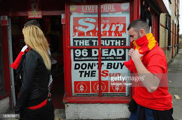 A poster protesting about the way in which Liverpool fans were blamed for the Hillsborough disaster is displayed outside the stadium before the...