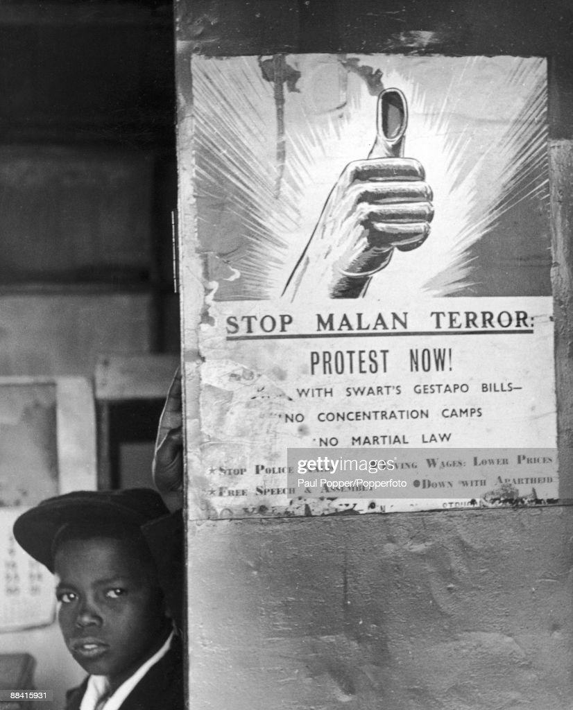 A poster put up by the African National Congress, protesting at the policies of South African Prime Minister Daniel Francois Malan, Durban, South Africa, circa 1954.