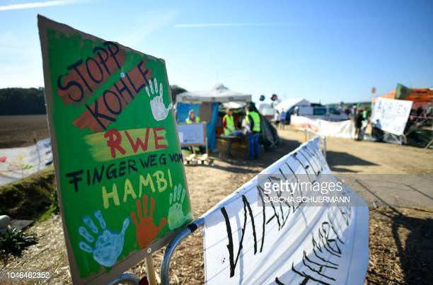 A poster reading Stop coal RWE hands off Hambi is seen as demonstrators gather on October 6 2018 close to the Hambacher Forst forest near Buir and...