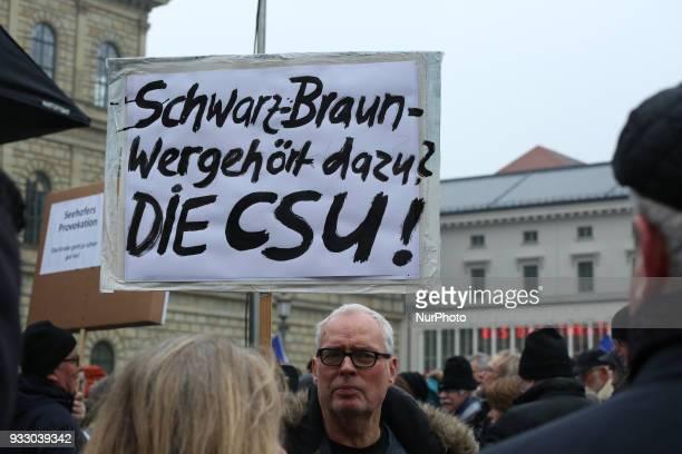 Poster saying 'SchwarzBraun wer gehört dazu DIE CSU' 'BlackBrown Who participates The CSU' Thousands of antiracist protestors gathered under the...