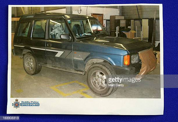 A poster showing a photograph of Mark Bridger's Land Rover Discovery is displayed at a DyfedPowys Police press conference where Coral Jones made an...