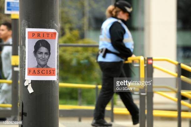 Poster showing Britain's Home Secretary Priti Patel is seen on a post as demonstrators protest against the Police, Crime, Sentencing and Courts Bill...