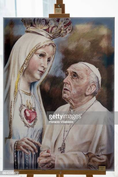 A poster showing Pope Francis praying to the Virgin Mary sells for 100 euros at the Museum of Sacred Art and Ethnology of Consolata Missionaries on...