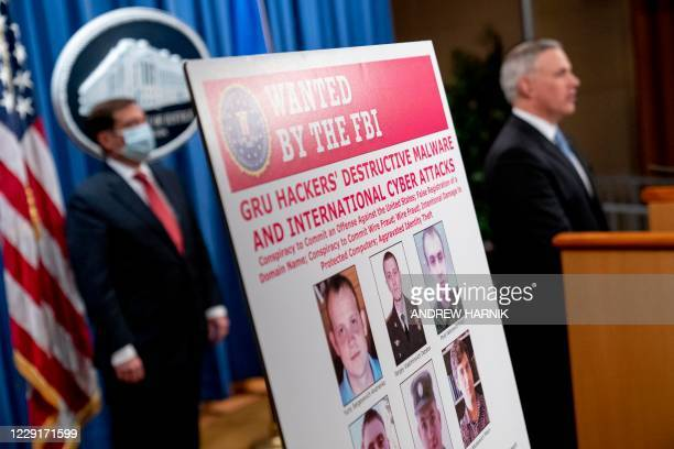 Poster showing six wanted Russian military intelligence officers is displayed as US Attorney for the Western District of Pennsylvania Scott Brady,...