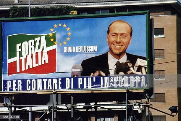 Poster showing the face of Prime Minister Silvio Berlusconi and the symbol of Forza Italia paty for the European elections campaign on May 12, 1994...